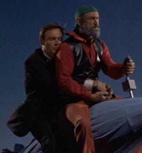 Adam West as Bruce Wayne and Gil Perkins as Bluebeard from Batman.