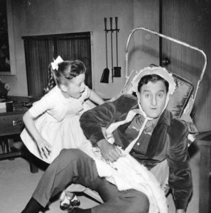 Angela Cartwright and her television dad, Danny Thomas, play house in a publicity photo from the television program, Make Room for Daddy.
