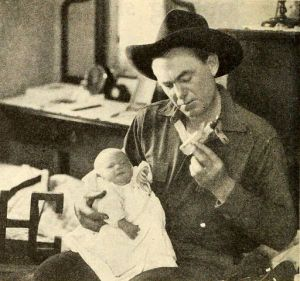 Harry Carey and his son Harry Carey, Jr., at 8 days old, September 1921 Photoplay.